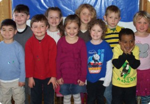 """Some of the Woods Hole Village Preschool students who have collected change during each school year for Wings for Falmouth Families"""